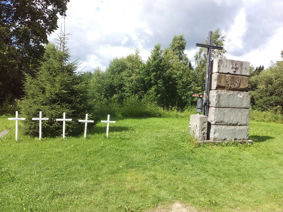 August 2017. Memorial cross and graves