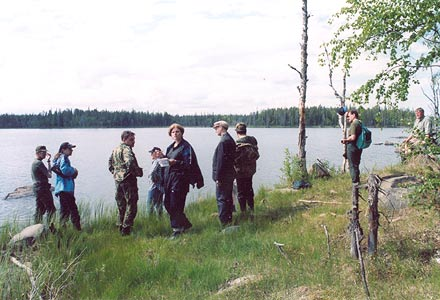 July 2003. Vazhenvaara. The members of the expedition at the place where the remnants of the 44th division returned to the Soviet territory